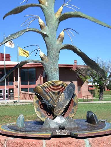 Corn stalk with basket statue.