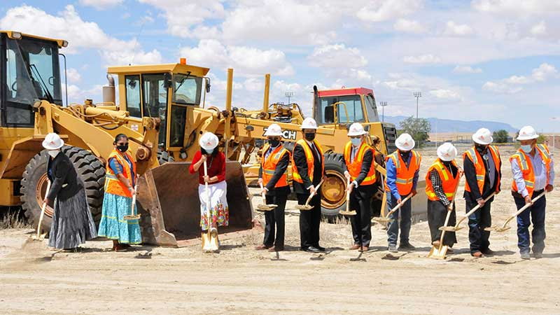 Navajo leaders and members of the Board of Regents from left to right push their shovels into the ground and lift dirt to kick off construction of the $7.4 million Diné College math and science building on June 28th.
