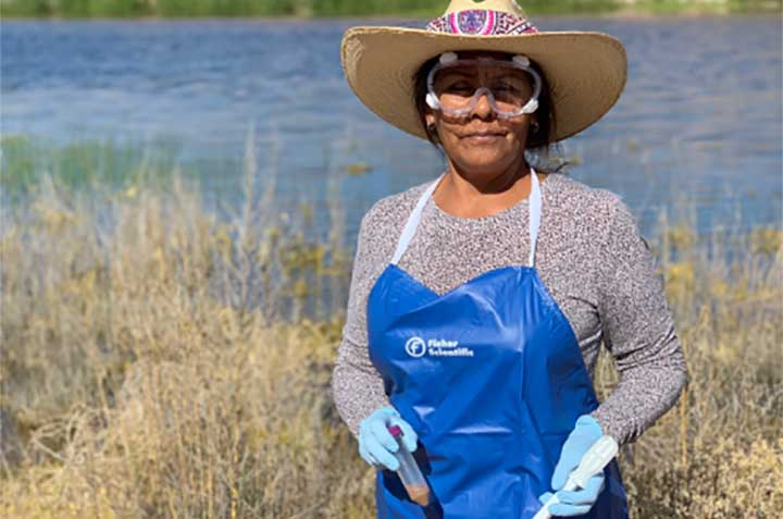 Diné College's School of S.T.E.M. student, Ms. Tina Du Puy collecting soil samples in 2019.