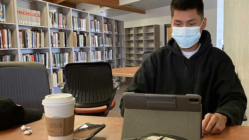 First-time freshman Shawn Charley studying in the Kinyaa'áanii Library at the Tsaile Campus.